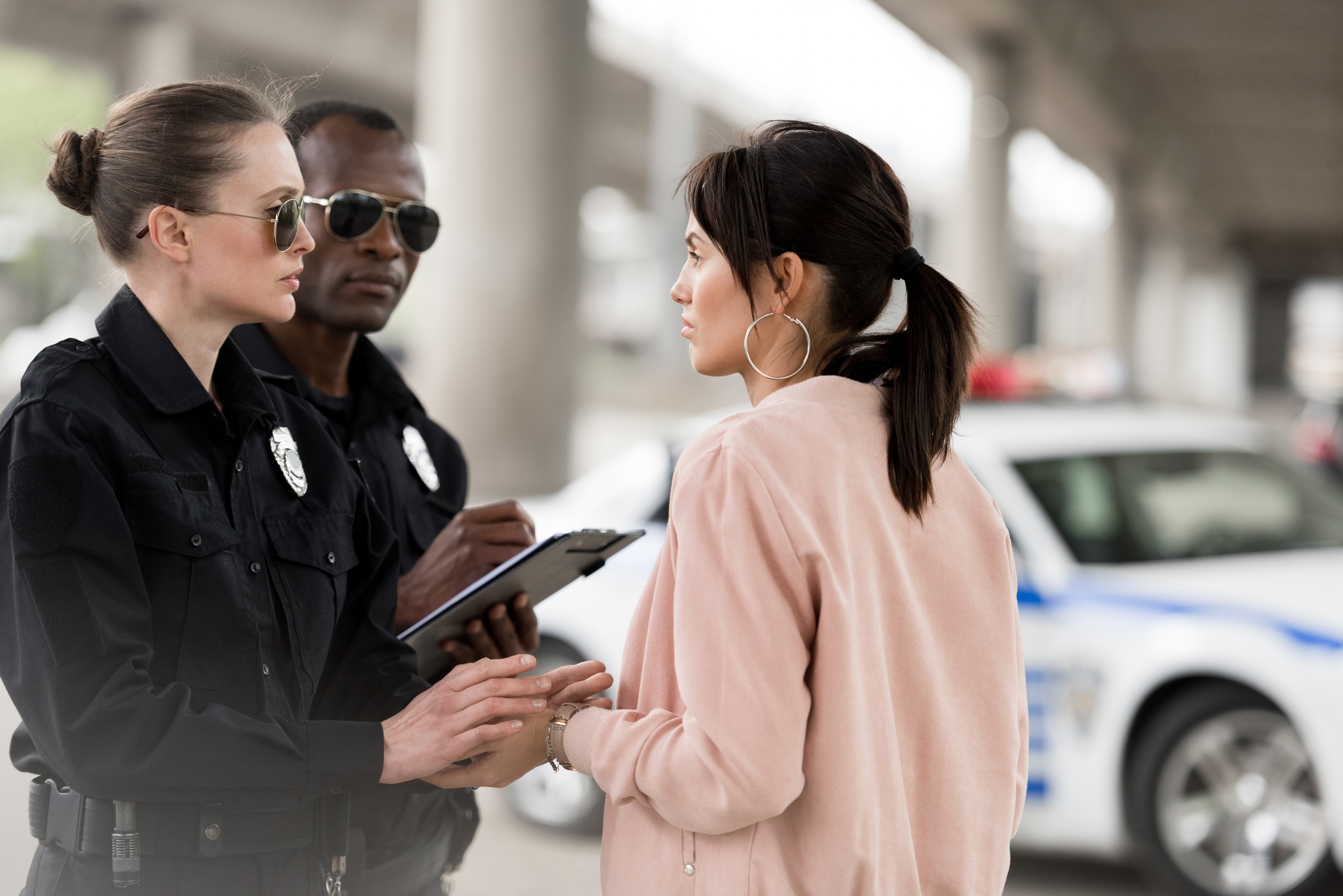 Stock photo - Officers with woman